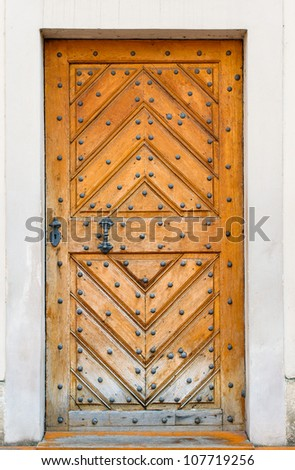Old wooden church door in Prague - stock photo