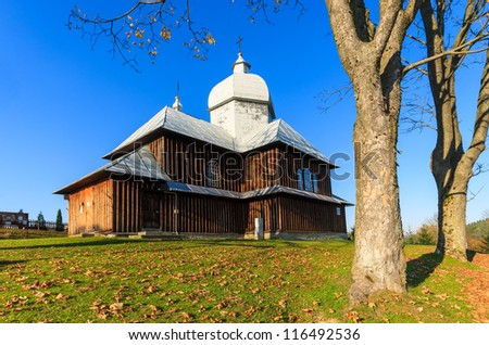 Old wooden church in Bieszczady Mountains at autumn season, Poland