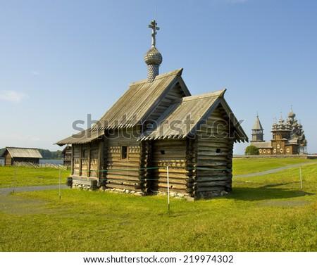 Old wooden churches on island Kizhi on Onega (Onezhskoye) lake in region Karelia on North of Russia, UNESCO World Heritage site. - stock photo
