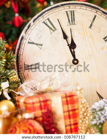Old wooden clock and Christmas decorations. New year concept - stock photo