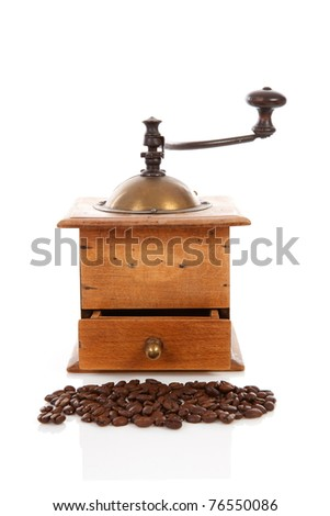 Old wooden coffee grinder over white background