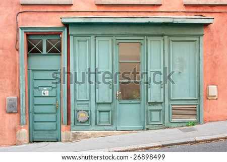 Old wooden door at city of Lyon - stock photo