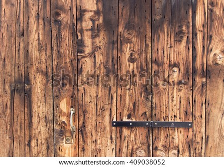 old wooden door background. closeup, natural oak tree planks surface. weathered, rustic wood material. brown color textured wallpaper. exterior timber panel - stock photo