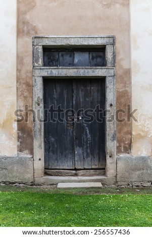 old wooden door in a country house - stock photo
