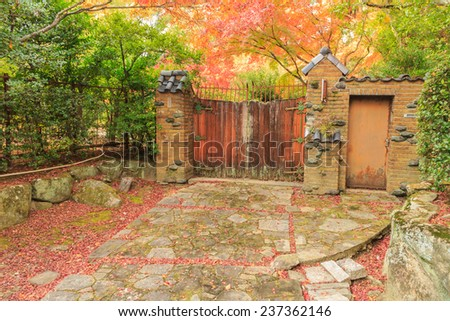 Old wooden door in autum - stock photo