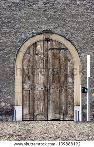Old wooden door in Grenoble, France.