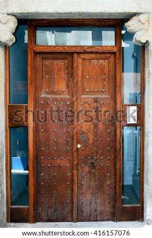 Old wooden door in Segovia, Spain - stock photo