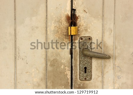 Old wooden door lock. - stock photo