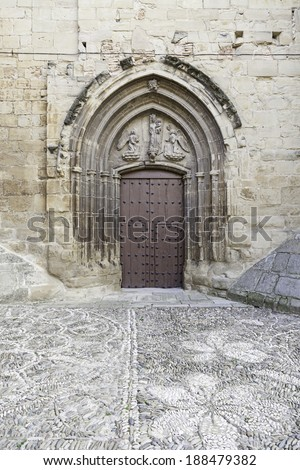 Old wooden door of a medieval church, detail of a decorated door, protecting, historic monument - stock photo