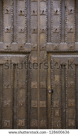 Old wooden door, old door detail of classic wood texture background with historical - stock photo