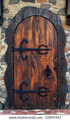 Old wooden door. Old-fashioned pub doorway - stock photo
