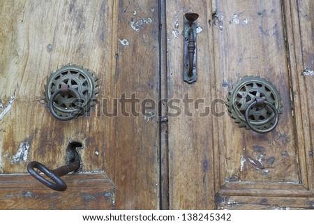 Old wooden door with old lock - stock photo