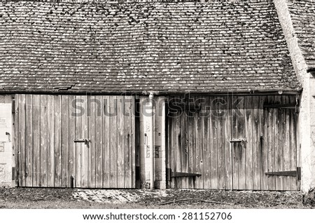 Old Wooden Doors in an old barn - stock photo