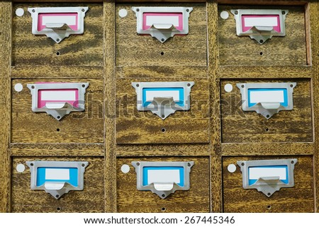 Old wooden drawers with catalog cards in library - stock photo