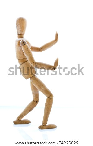 Old wooden dummy try to stopping something