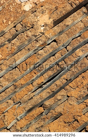 Old wooden earthen wall, background texture