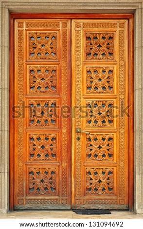 Old wooden entrance door - stock photo