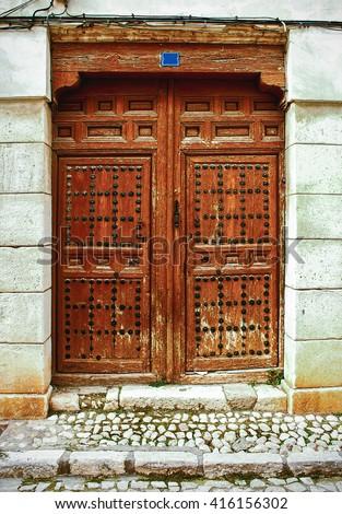 Old wooden entrance door in Chinchon, Toledo, Spain - stock photo