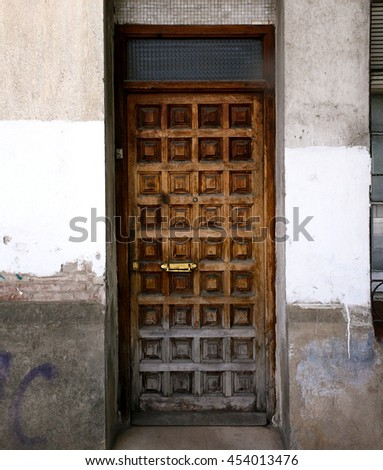 Old wooden entrance door in Gualadajara, Madrid, Spain - stock photo