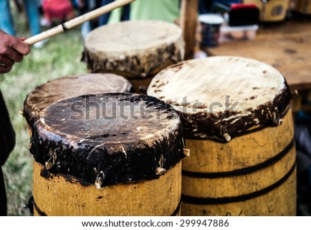 old wooden ethnic drums outdoors - stock photo