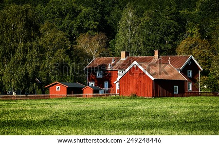 old wooden farm set in a beautiful rural surrounding - stock photo
