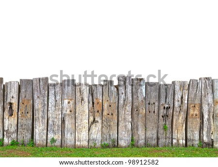 old wooden fence in garden with grass - stock photo