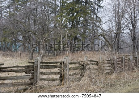 old wooden fence in the country - stock photo