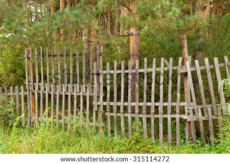 old wooden fence in the forest