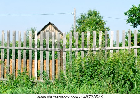 Old wooden fence in the garden