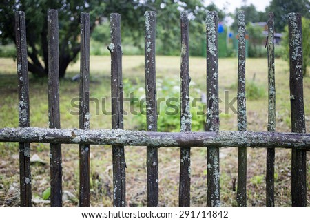 old wooden fence on a country site - stock photo
