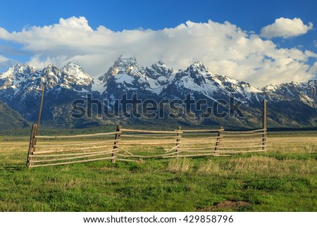 Old wooden fence with sunrise on the Grand Teton, Wyoming, USA. - stock photo