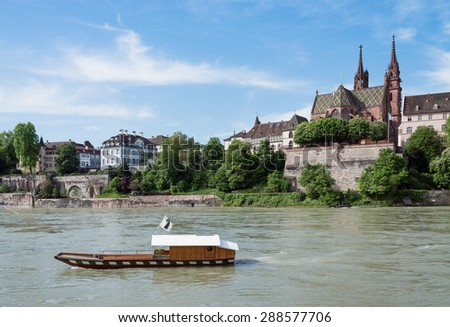 Old wooden ferry crossing the Rhine river at Basel, Switzerland - stock photo