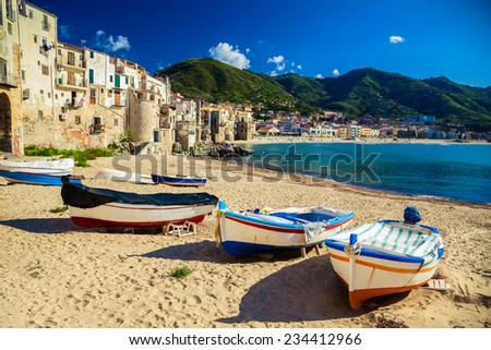 old wooden fishing boats on the beach of Cefalu - stock photo