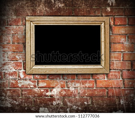 Old wooden frame on the grunge wall - stock photo