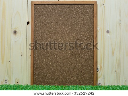 old wooden frame with green grass background