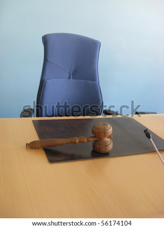 Old wooden gavel,blue chair and court desk