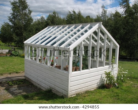 old wooden greenhouse - stock photo