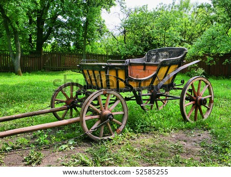 Old wooden horse Carriage in the garden