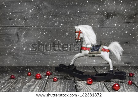 Old wooden horse - shabby chic Christmas decoration - background for a greeting card - stock photo