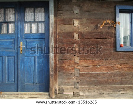 Old wooden house detail close-up, tomato on window sill - stock photo