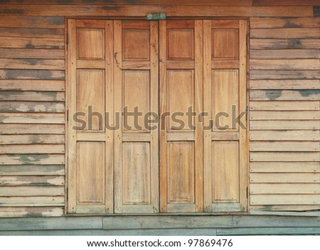 Old wooden house door, Thailand traditional style - stock photo