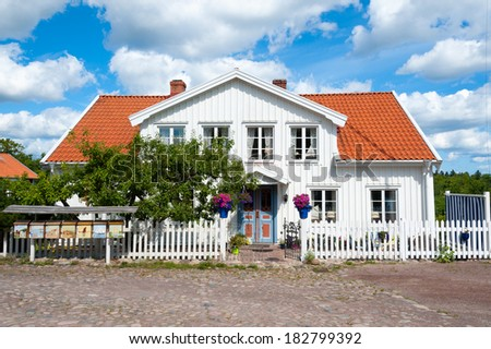 Old wooden house from the 19th century in the small coastal place Pataholm at the swedish east coast. Sweden, Kalmar district. - stock photo