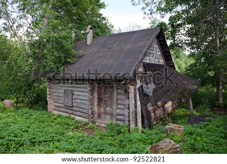 Old wooden house in russian village - stock photo