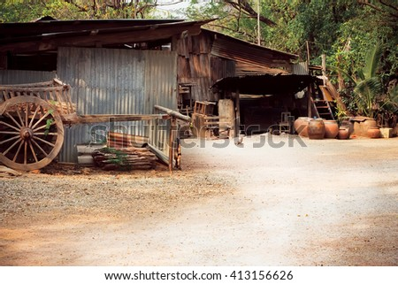 Old wooden house with clay pots in the Thai village - stock photo