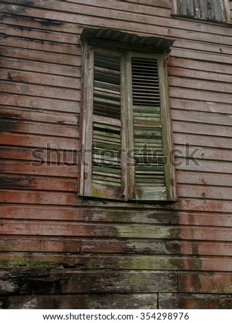 Old wooden house with window - stock photo
