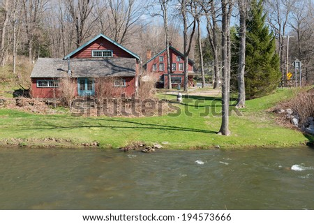 Old wooden houses by a river, New York State, USA
