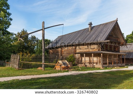 Old wooden hut in the village on a summer day. Museum of Wooden Architecture Vitoslavlitsy around Veliky Novgorod