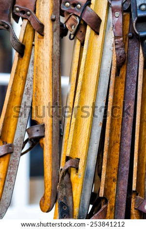 Old wooden ice skates in Amsterdam, Netherlands. - stock photo