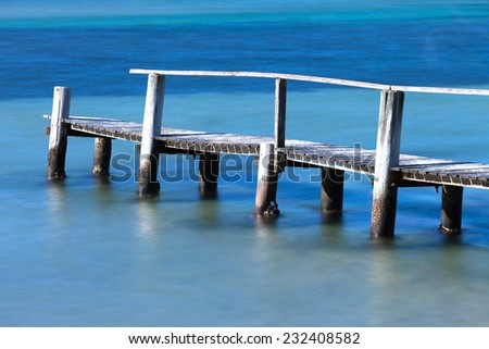 Old wooden jetty at Merimbula, NSW Australia - stock photo