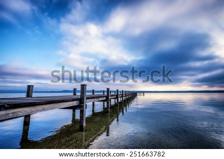 old wooden jetty at the chiemsee lake in bavaria - stock photo